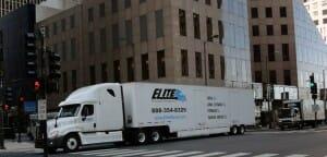Elite-moving-storage-driving-truck-city
