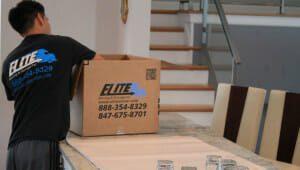 Elite-moving-worker-packing-glasses