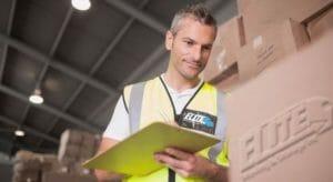 Elite storage employee checking spring cleaning storage inventory