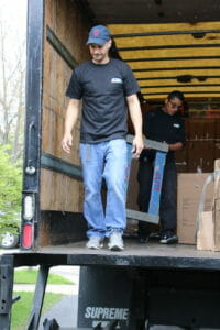 Elite movers unloading moving equipment