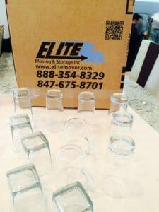 Elite movers drinking glasses fragile