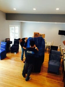 Elite movers carry furniture hardwood floors moving pads