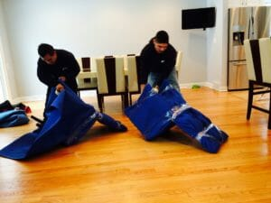 Elite movers packing chairs moving pads