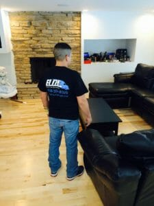 Elite moving employee in living room