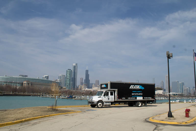 Elite moving truck, Chicago River, skyline, Sears tower