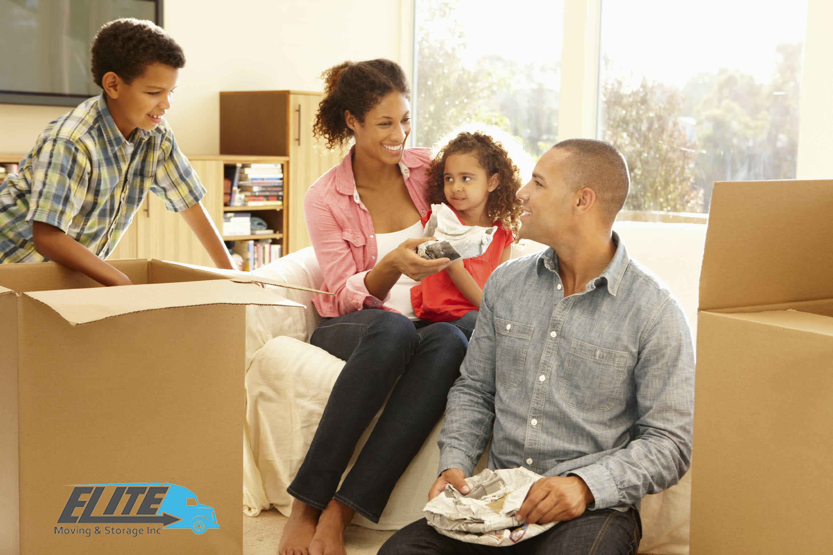 Family-unpacking-boxes-new-home
