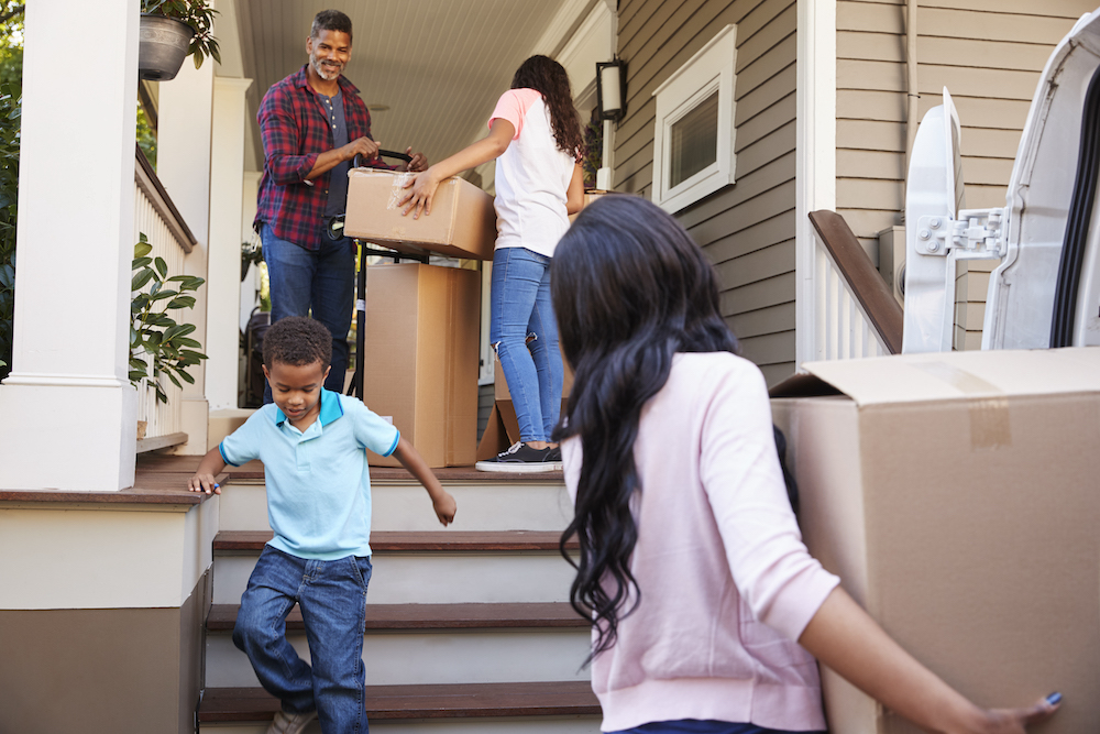 children helping their parents move into a new house